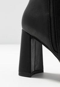 NA-KD - ANGULAR HEEL BOOTIES - High heeled ankle boots - black - 2