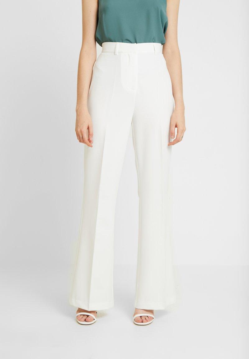 NA-KD - TINA MARIA FRONT SEAM BOOTCUT PANTS - Pantalones - white