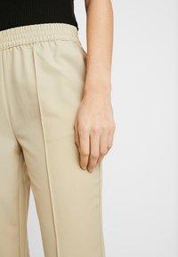 NA-KD - ELASTIC WAIST SEAMLINE PANTS - Pantalon classique - beige - 4