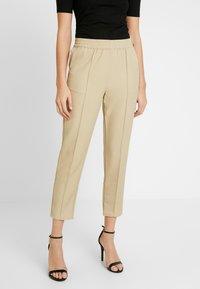NA-KD - ELASTIC WAIST SEAMLINE PANTS - Pantalon classique - beige - 0