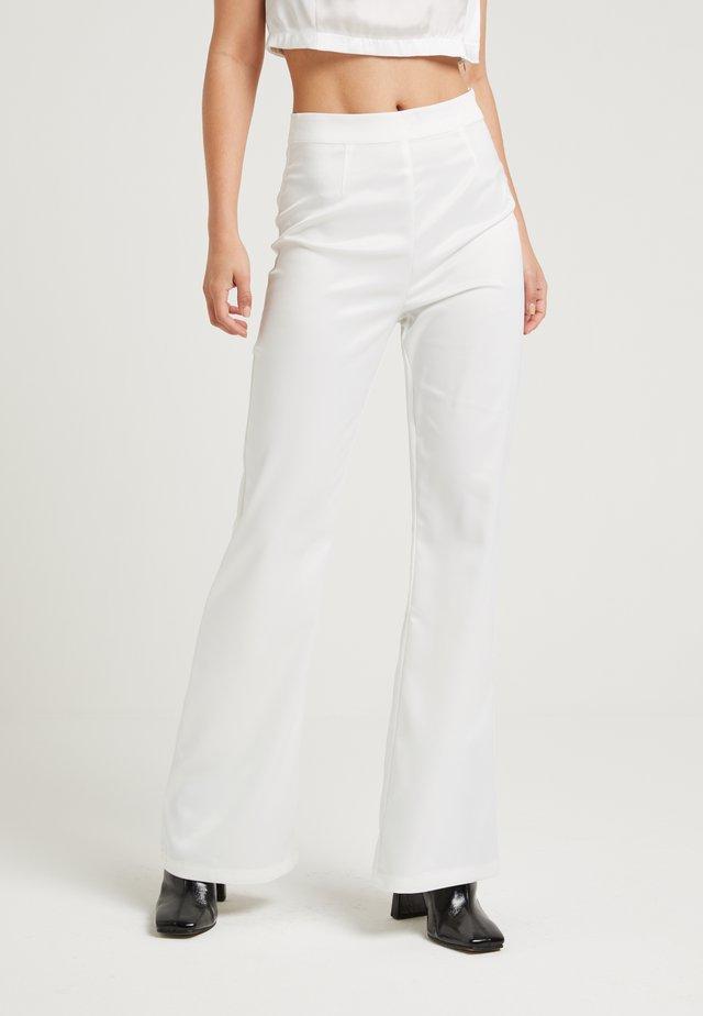 SHINY FLARE SUIT PANTS - Kangashousut - white