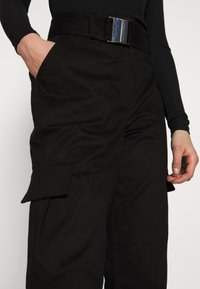 NA-KD - KNOT DETAIL CARGO PANTS - Trousers - black - 3