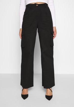 Misslisibell x NA-KD - Spodnie materiałowe - black