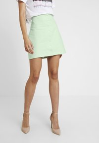 NA-KD - QUEEN OF JETLAGS FRONT BUTTON SKIRT - A-line skjørt - dusty light green - 0