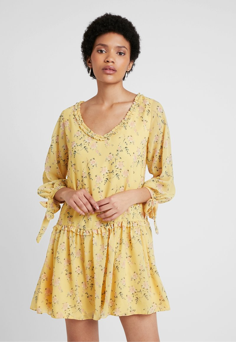 NA-KD - KAE SUTHERLAND RUFFLE V NECK MINI DRESS - Day dress - yellow