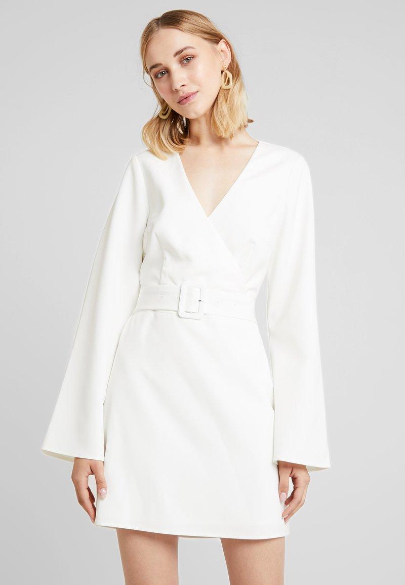 NA-KD - LINN AHLBORG OPEN BACK MINI DRESS - Vestido informal - white