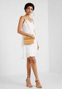 NA-KD - DOBBY DOT DRESS - Denní šaty - white - 1