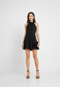 NA-KD - PAMELA REIF X  NA-KD HALTER NECK SKATER DRESS - Jersey dress - black - 2