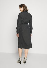 NA-KD - FRONT BUTTON BELTED DRESS - Shirt dress - black - 2
