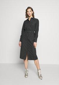 NA-KD - FRONT BUTTON BELTED DRESS - Shirt dress - black - 1
