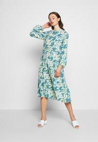 NA-KD - RUFFLE DRESS - Day dress - yellow - 1
