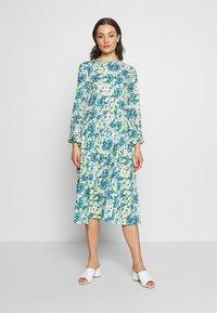 NA-KD - RUFFLE DRESS - Day dress - yellow - 0