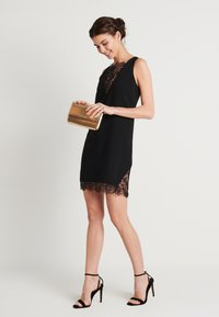 NA-KD - ZALANDO X NA-KD V-NECK DETAIL DRESS - Juhlamekko - black