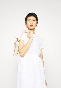 NA-KD - SHORT SLEEVE ANGLAISE DRESS - Skjortekjole - white - 3