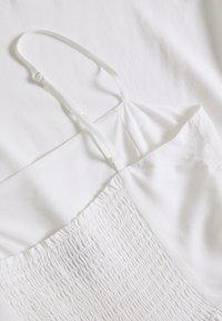 NA-KD - PAMELA REIF X NA-KD FLOWY MINI DRESS - Day dress - white - 2