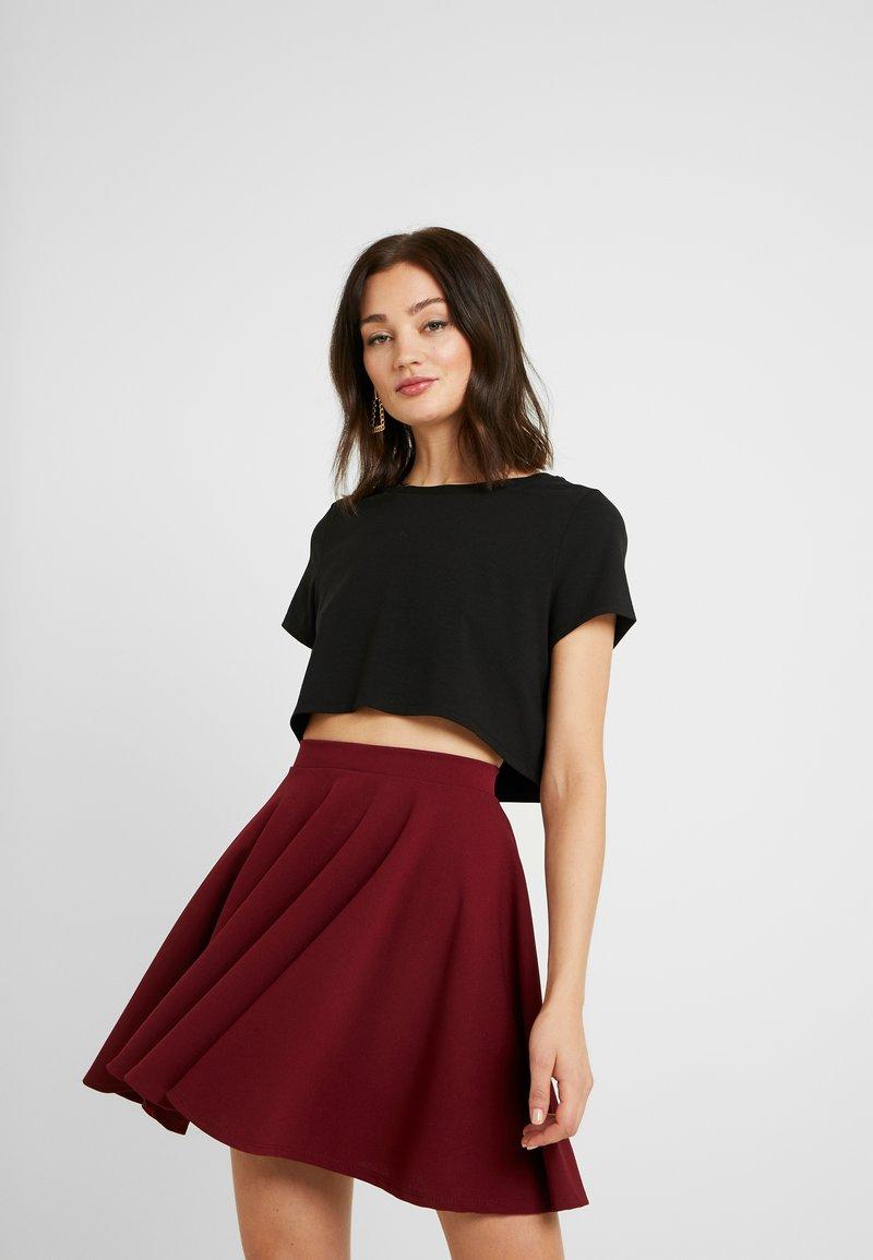 NA-KD - Pamela Reif x NA-KD RAW HEM CROPPED - Basic T-shirt - black