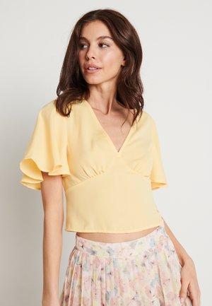 ZALANDO X NA-KD V-NECK FLOWY BLOUSE - Blus - yellow