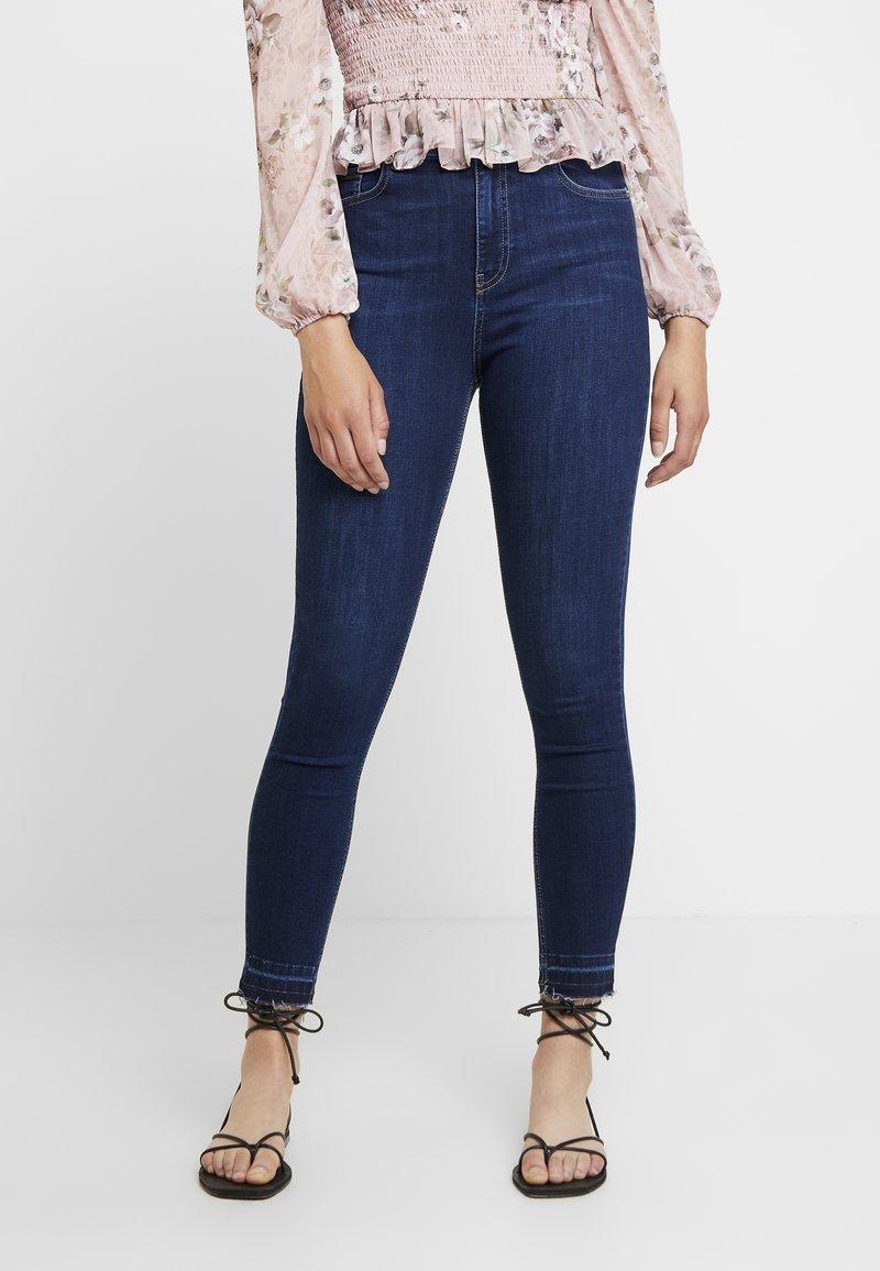 NA-KD - HIGH WAIST OPEN HEM - Jeans Skinny Fit - dark blue