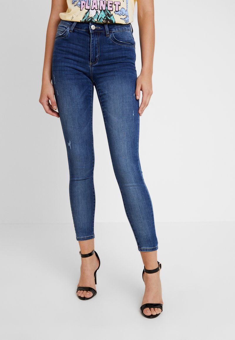 NA-KD - MID WAIST DESTROYED - Jeans Skinny Fit - mid blue