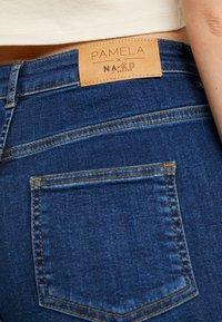 NA-KD - Pamela Reif x NA-KD HIGH WAIST - Skinny džíny - dark blue - 4