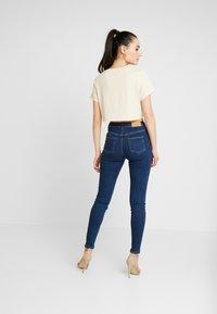 NA-KD - Pamela Reif x NA-KD HIGH WAIST - Skinny džíny - dark blue - 2