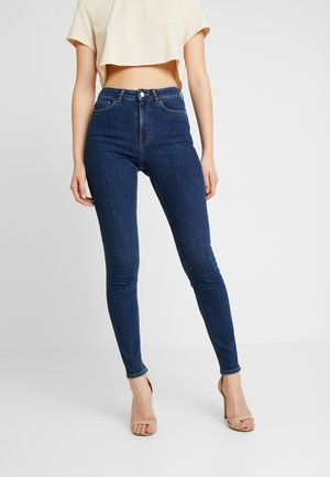 Pamela Reif x NA-KD HIGH WAIST - Jeans Skinny Fit - dark blue