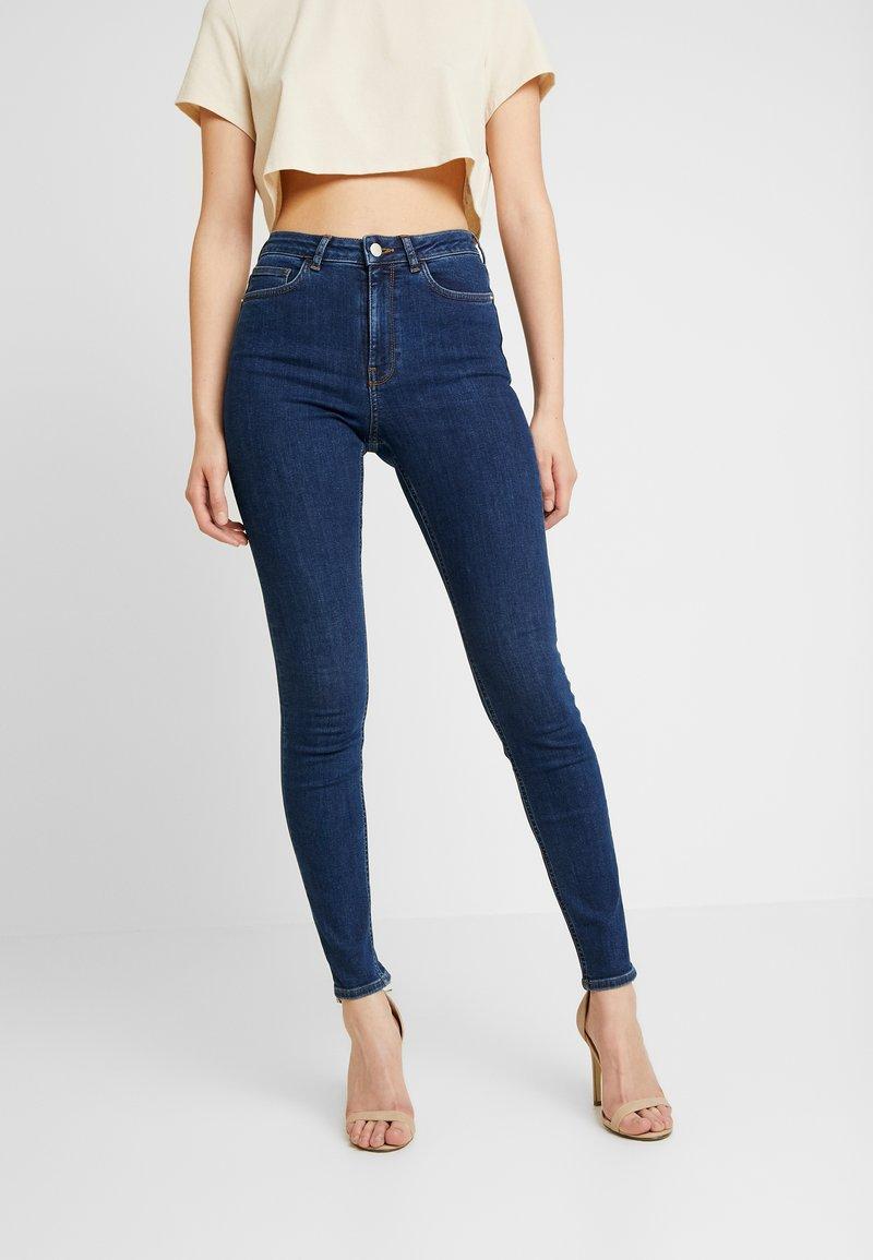 NA-KD - Pamela Reif x NA-KD HIGH WAIST - Jeans Skinny Fit - dark blue