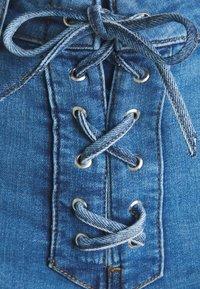 NA-KD - Pamela Reif x NA-KD TIE DETAIL - Denim shorts - light blue - 2