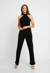 NA-KD - HIGH NECK - Tuta jumpsuit - black - 0