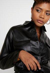 NA-KD - BELTED JACKET - Faux leather jacket - black - 5