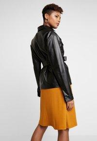 NA-KD - BELTED JACKET - Faux leather jacket - black - 2