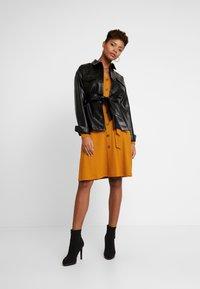 NA-KD - BELTED JACKET - Faux leather jacket - black - 1