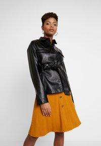 NA-KD - BELTED JACKET - Faux leather jacket - black - 0