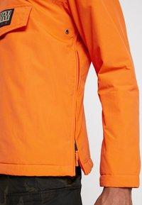 Napapijri The Tribe - RAINFOREST - Light jacket - orange puffin - 5