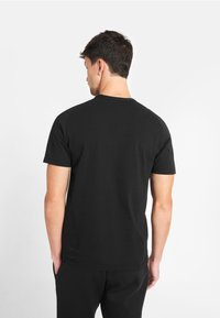 National Geographic - Print T-shirt - black