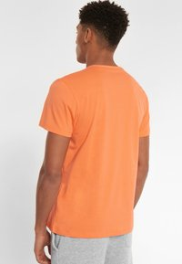National Geographic - Print T-shirt - coral - 1