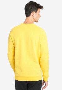 National Geographic - WITH LOGO - Sweatshirt - lemon chrome - 1