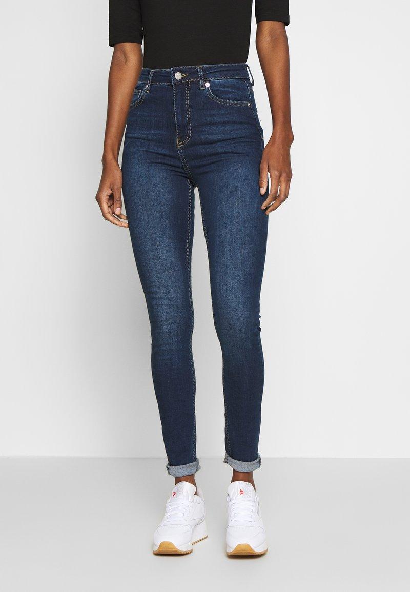 NA-KD Tall - HIGH WAIST RAW TALL - Jeans Skinny Fit - dark blue