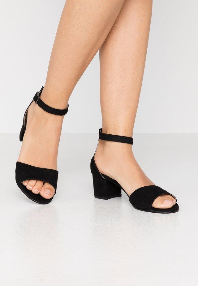 CORA - Sandalen - black