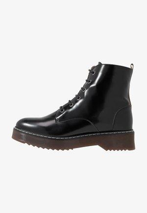 TRINA - Platform ankle boots - black