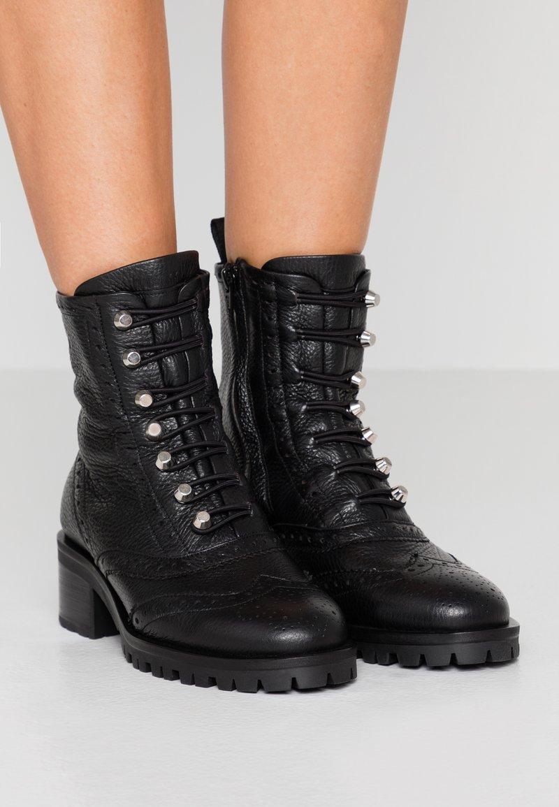Nubikk - DJUNA BROGUE - Lace-up ankle boots - black