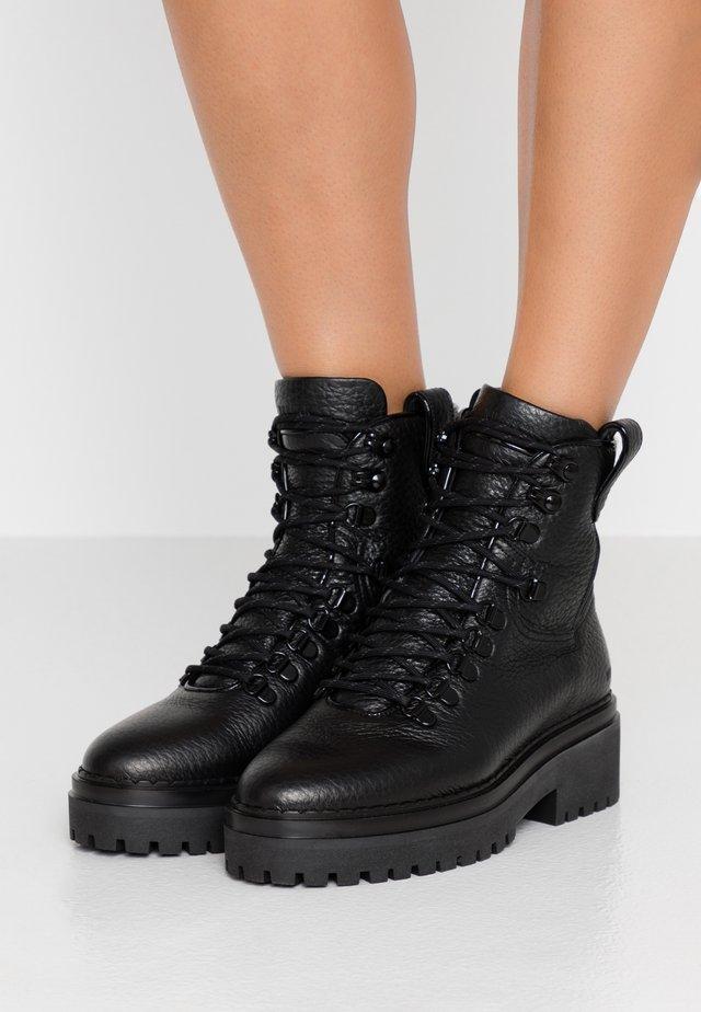 FAE ROMA - Platform ankle boots - black