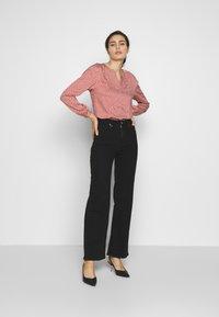 Neuw - MAGAZINE ALINE - Flared Jeans - black denim - 1