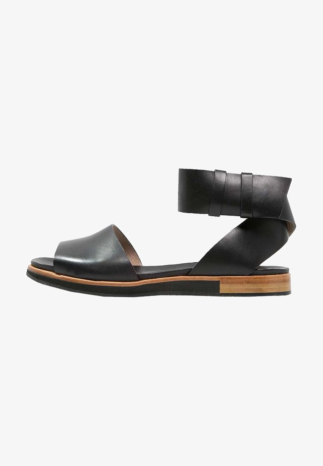 Sandaalit nilkkaremmillä - ebony