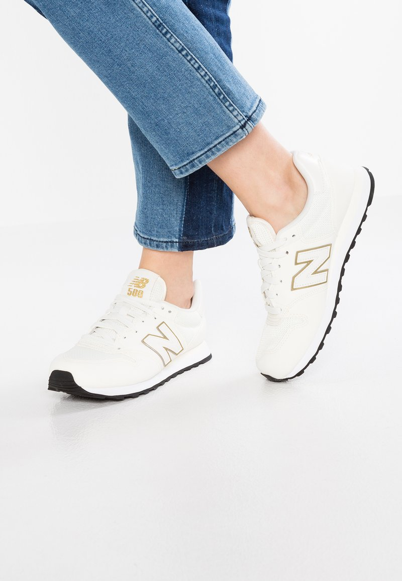 New Balance - GW500 - Sneakersy niskie - white/gold