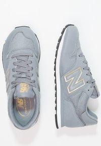 New Balance - GW500 - Sneakersy niskie - grey/gold - 2