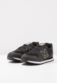 New Balance - GW500 - Sneakersy niskie - black/gold - 3