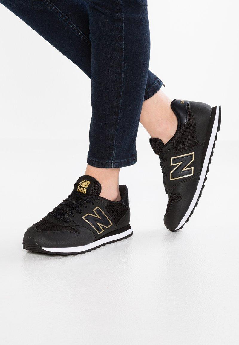 New Balance - GW500 - Sneakersy niskie - black/gold