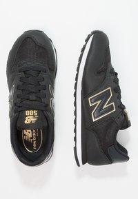 New Balance - GW500 - Sneakersy niskie - black/gold - 2