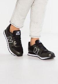 New Balance - GW500 - Sneakersy niskie - black - 0